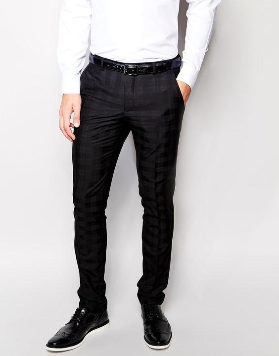 Anzughose von Vito karierter Stoff verdeckter Reißverschluss seitliche Taschen und zwei Gesäßtaschen schmale Passform, sitzt eng am Körper Chemisch reinigen 80% Polyester, 20% Viskose unser Model trägt 32 Zoll/81 cm und ist 188 cm/6 Fuß 2 Zoll groß