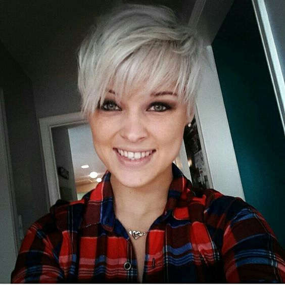 White blonde messy pixie cut.