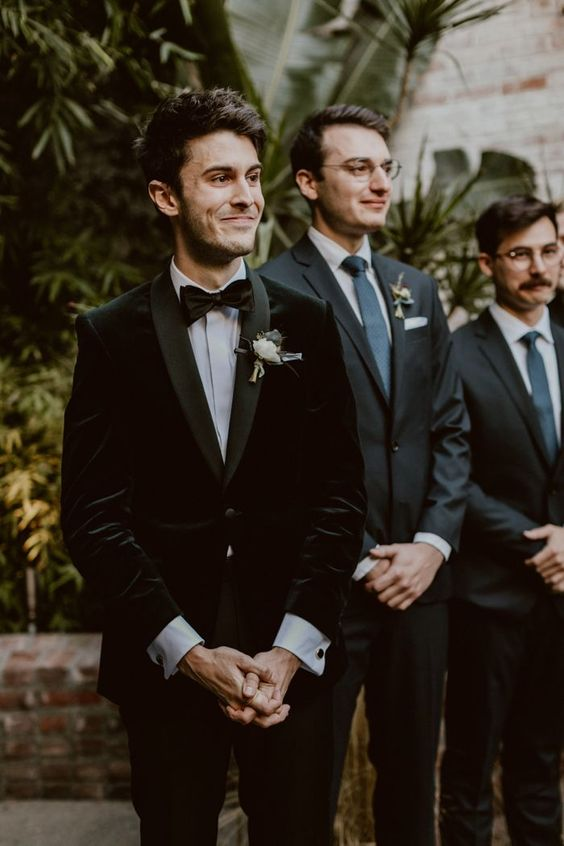 Velvet suit jacket + classic bow tie for the groom | Image by Jes Workman