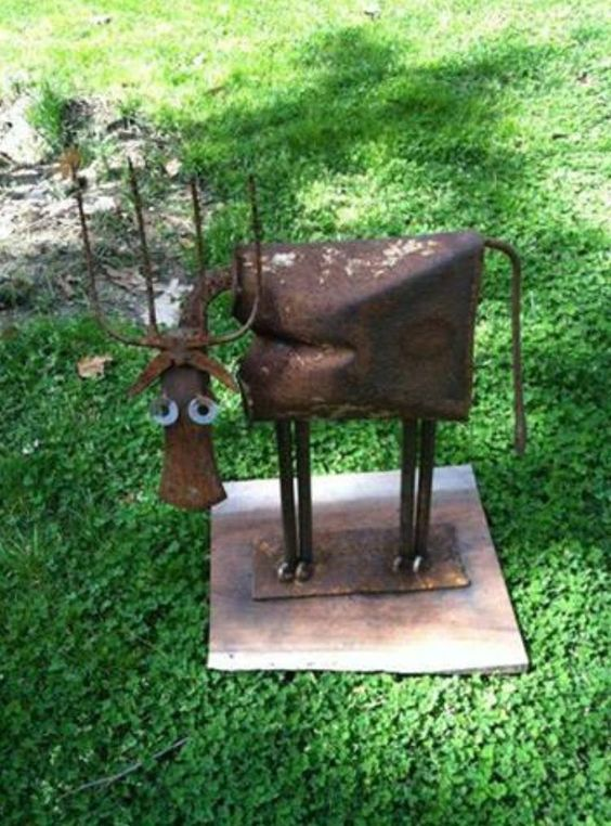 Garden art deer from an old shovel axe head pitch fork for Used tire yard art