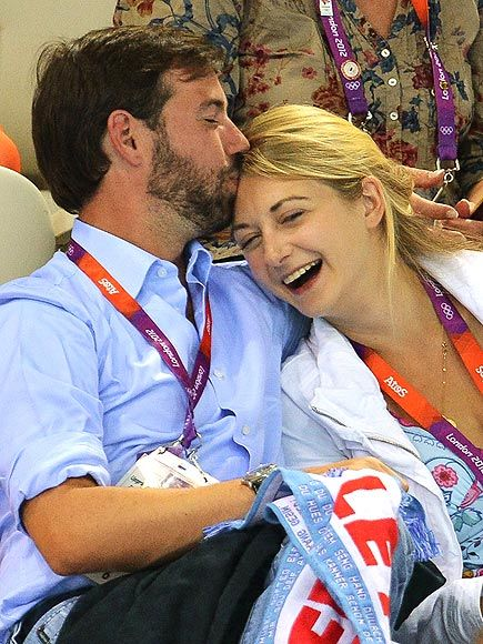 LUXEMBOURG: GRAND DUKE GUILLAUME & STÉPHANIE DE LANNOY  Also rooting for his countrymen: Luxembourg's heir to the throne, who stops to give his giggly fiancée a sweet kiss during the July 31 swimming competition.