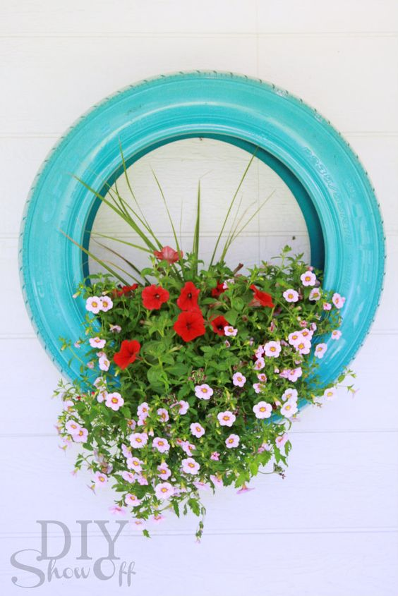 tire flower planter decor - would be cute on a fence in a line of three