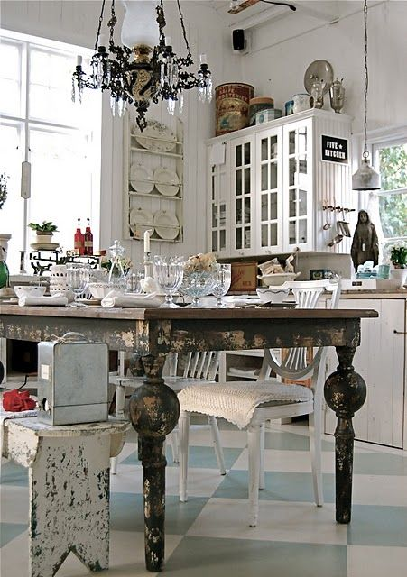 Lots going on here, but like many elements individually (plate rack, bench, table, floor tiles, chairs and what appears to be placemats (?) placed over the chair seats)