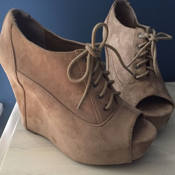 Faux Suede Open Toe Lace Up Wedge Booties Perfect for a night out or a casual day date. They are a chestnut/beige open toed booties. The lace up detail is perfect for dressing up or down. Worn once. Gently used and still in great condition. The marks shown one the outside of the third picture are not wears or tears they are just the movement of the suede. Soda Shoes Wedges