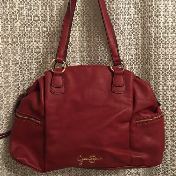 Deep red Jessica Simpson bag Can be used as a shoulder bag or comes with a strap to be a cross body. Brick red color with gold accents. Snap pockets on outside of both sides, open pockets inside and zipped pockets on both ends and back side. Leopard print inside. Used maybe 2-3x .. Great bag for anyone! Dress it up or down or even use as a diaper bag! Beautiful inside and out Function & Fringe Bags Shoulder Bags