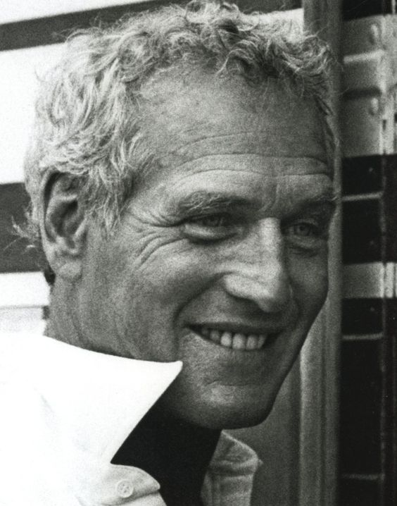 Paul Newman. I like my men to have all those wonderful age lines. It makes me wonder where they've been and what secrets they know. So damn sexy.: