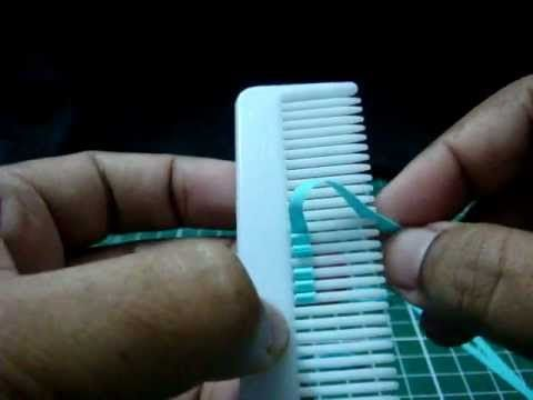 How to make quilled flowers using a hair comb.