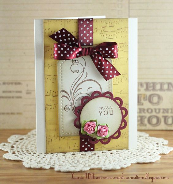 There are so many elements that I love on this! The colors, the flourished tag, the letterpressed background... Fab!