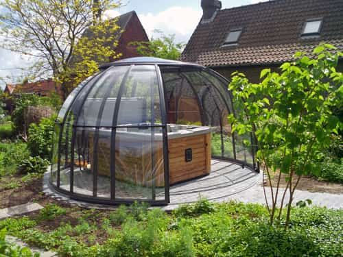 A round room is unique on its own and this one has retractable walls so you can enjoy the outdoors when it's warm. There's not a lot of room for anything but the hot tub, but it's still a nice enclosure.
