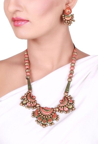 Multi-color Flower Terracotta necklace set Dimension of necklace: 9 inches Dimension of earrings: 2 inches Weight: 98 gms Color: Multi-color Closure: Necklace: String, Earring: Metallic lock Material: Terracotta clay Finish: Hand-crafted Inspiration: Elements Of Nature