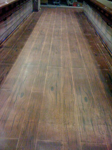 A wood floor made of concrete polish concrete floors for Hardwood floor concrete stamp