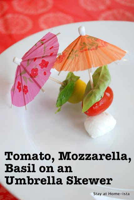 Cute party food: Tomato Mozzarella Basil on Cocktail Umbrella Skewers.
