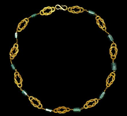 Roman Gold and Emerald Necklace | Circa 3rd-4th century AD | A composite necklace comprising eleven double-loop filigree plaques connecting ten hexagonal-section emerald cylinders; with loop and s-hook closure | 18 grams, 37.5 cm: