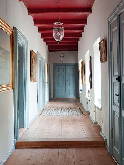 White walls, blue doors, red ceiling features