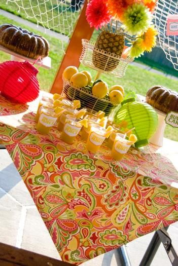 luau table. Love the fabric and the center piece with the pineapple. Use pineapple for topiary base?