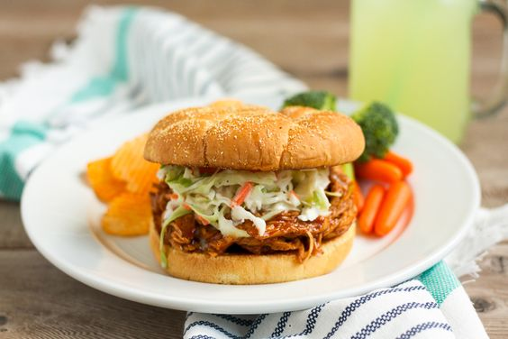 These barbecue chicken sandwiches are served on a buttered, griddled bun, and…
