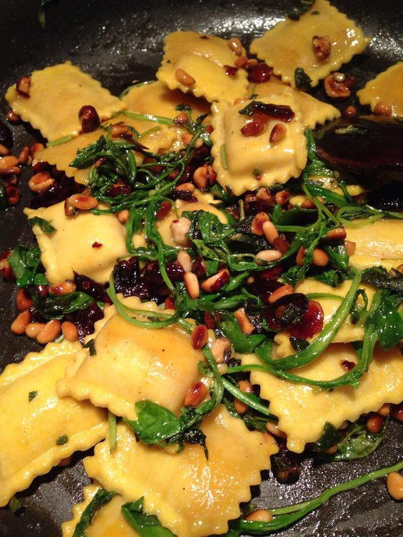 Home made pumpkin ravioli w/toasted pine nuts & hazel nuts, cranberries, arugula & Parmesan, sautéed in an excellent combo of olive oil & pumpkin oil... & I want more, NOW!!!!!