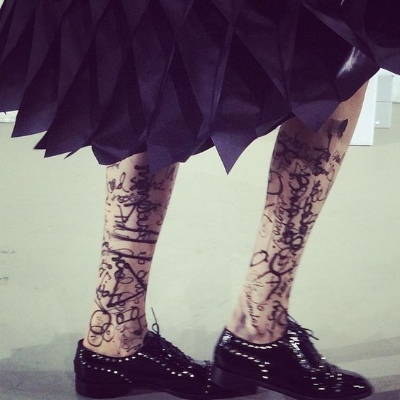 Graffitis on legs at Junya Watanabe