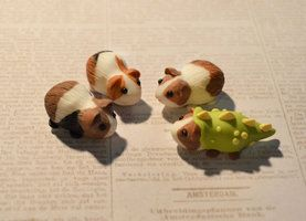 3 Pigs and a dinopig by insanable in polymer clay, painted...Deviant Art