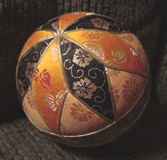 a non temari, but made with fabric and tucked into grooves.  Easier?  could use some silk from my collection...?