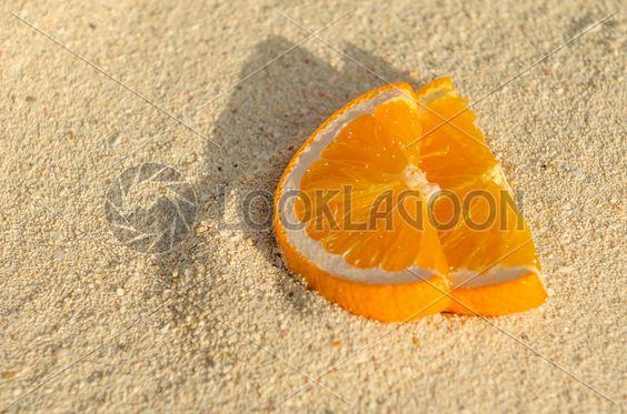 Orange Slices in Sand, via LookLagoon