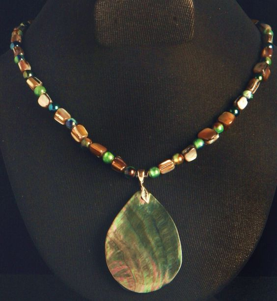 Abalone Shell Pendant with grey cube shells & Italian glass beads with shades of green ,gray and aqua that compliment the Abalone Pendant