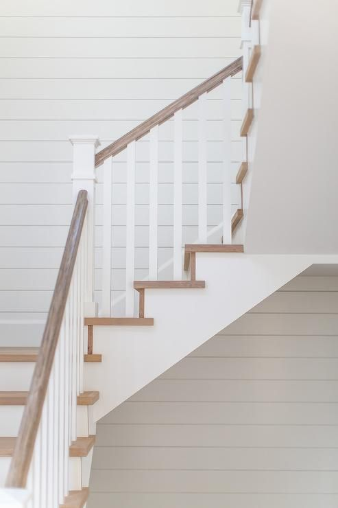 White Shiplap Complements A Two Tone Staircase Fitted With Gray Wash Wood Treads Matching A Gray Wash Wood Handrail Pai Wood Stairs Wood Railing Wood Staircase