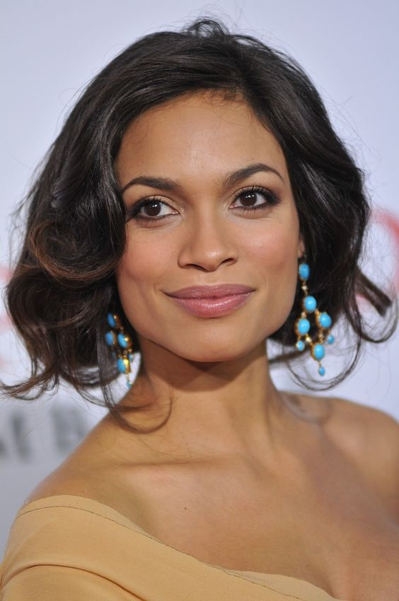 Rosario Dawson[2] (born May 9, 1979) is an American actress, singer, and writer. She has appeared in films such as Kids, Men in Black II, 25th Hour, Sin City, Clerks II, Rent, Death Proof, The Rundown, Eagle Eye, Alexander, Seven Pounds, Percy Jackson and the Olympians: The Lightning Thief, Unstoppable, Trance and Top Five.