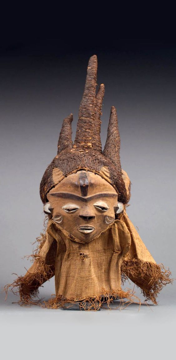 Africa | 'Pumbua nyanga' type dance mask from the Pende people of DR Congo | Wood, fiber, raffia cloth and pigment