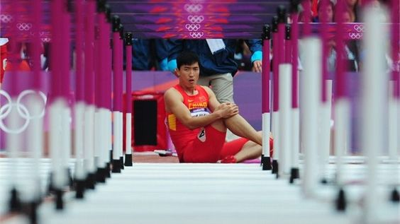 Great shot though bummed for this guy - Liu Xiang of China sits on the track after getting injured in the men's 110m Hurdles Round 1 Heats on Day 11 of the London 2012 Olympic Games at the Olympic Stadium