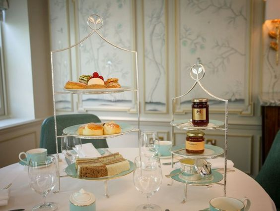 """""""Jubilee Tea Salon. Meanwhile, Fortnum & Mason's tea salon was officially opened in the store by the Queen—along with the Duchess of Cornwall and the Duchess of Cambridge—this past March. Elegantly decorated by David Collins, prices start at £ 38 per person for tea.""""  [Slide 15 of 30.]"""