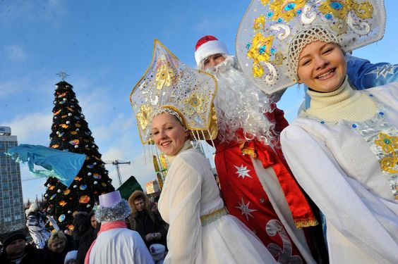 Men wearing costumes of Ded Moroz (Grandfather Frost), the Santa Claus in Russia, Belarus and Ukraine, and women wearing costumes of Snegurochka (Snow Maiden), the traditional companion of Ded Moroz, smile during their parade in Minsk on Dec. 25, 2013.