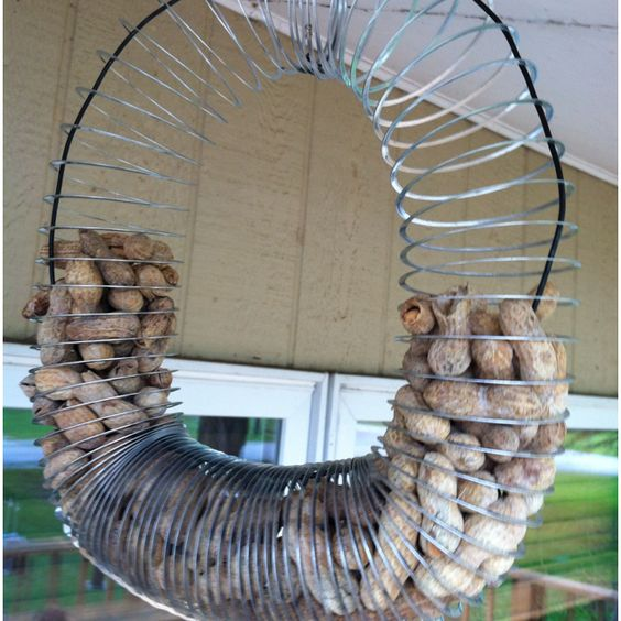 homemade slinky squirrel feeder my things things i have made pinterest homemade. Black Bedroom Furniture Sets. Home Design Ideas