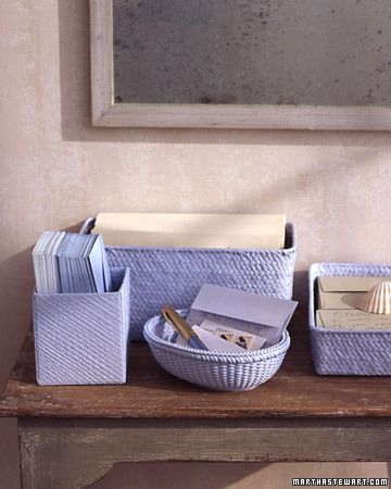 With a single coat of latex paint, you can unify mismatched gift baskets to be used as household organizers.