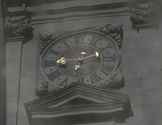 """Time Warp"" ~ clock reflection in a puddle, Salzburg Cathedral"