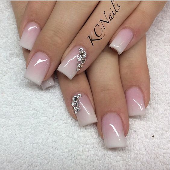 Beautiful pink to white fade acrylic nails! Love the colors