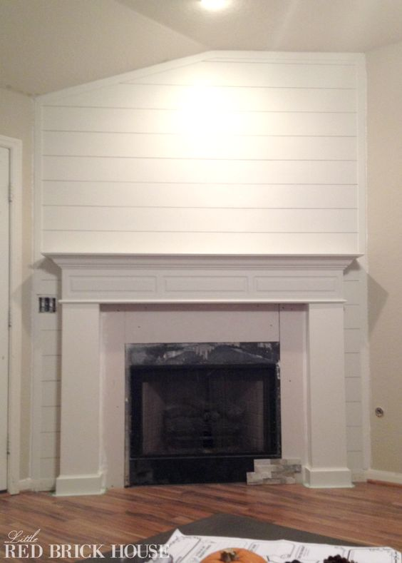 Fireplace makeover planked wall tutorial pinterest we - Floor to ceiling brick fireplace makeover ...