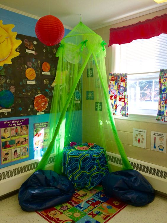Cozy Corner for your classroom. This space can be utilized for children who are upset and want to use self soothing strategies such as: candles taped to flowers to practice deep breaths, a bowl of paper to rip negative emotions away, soft stuffed animals to hold or squeeze, and an emotion wheel/thermometer to recognize and understand the feelings he/she is experiencing. Works great for our class of 3 year olds!