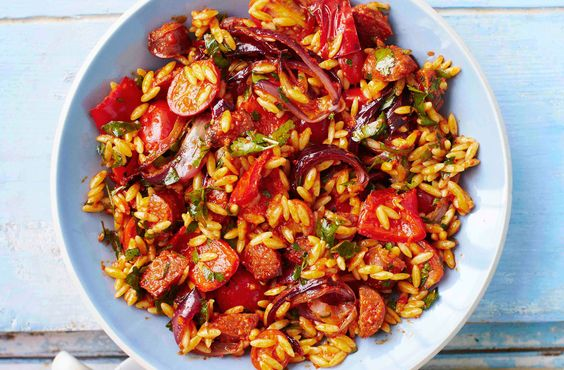 This wonderfully colourful and flavoursome Spanish salad combines red peppers, red onion, chorizo and cherry tomatoes with orzo pasta.