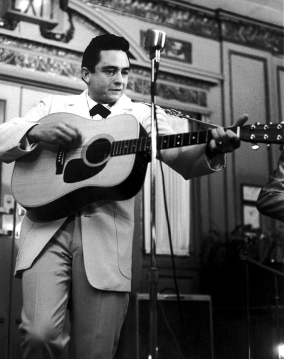 Cash in white, debuting songs from 'The Fabulous Johnny Cash' @ a Nashville press party, February 1959.