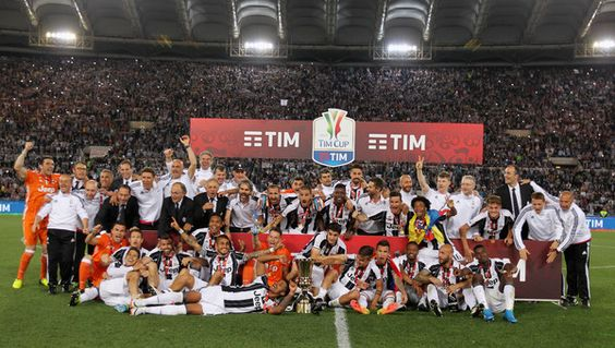 Juventus FC players celebrate with the trophy after winning the TIM Cup final match against AC Milan at Stadio Olimpico on May 21, 2016 in Rome, Italy.