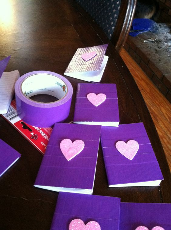Big Book of BooBoos.  Mini composition books from the dollar store, purple duct tape and glitter foam hearts