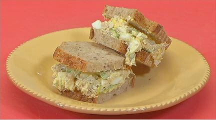 A combination of chicken and egg salad sandwiches with thinly sliced asparagus!