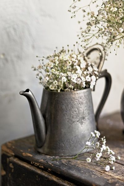 rustic-baby's-breath in old pewter like tea pot