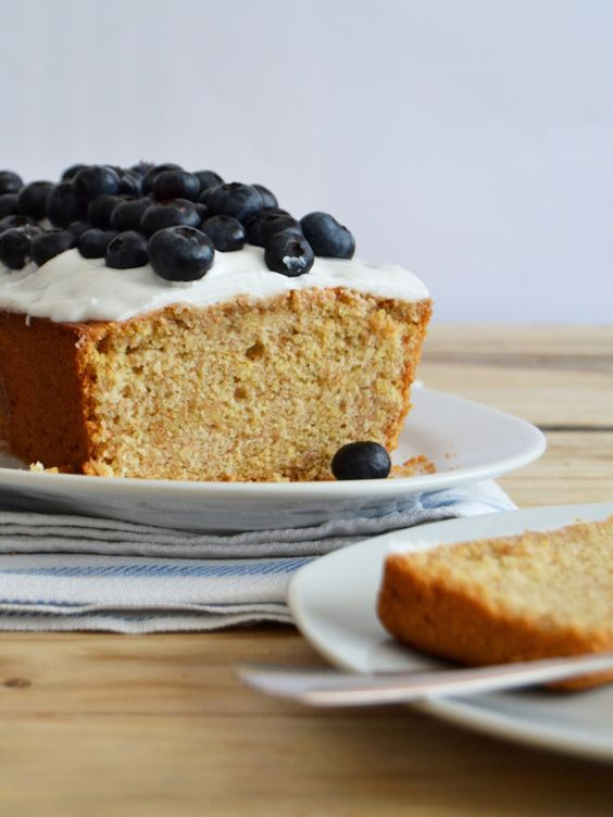 Lemon pound cake with coconut frosting and blueberries