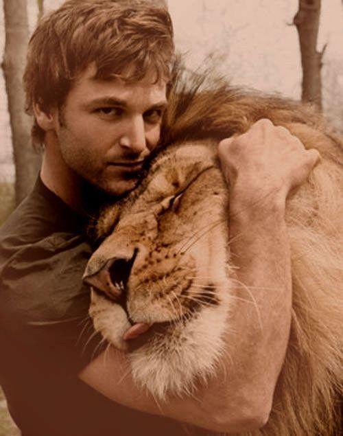 lion hugs rock.