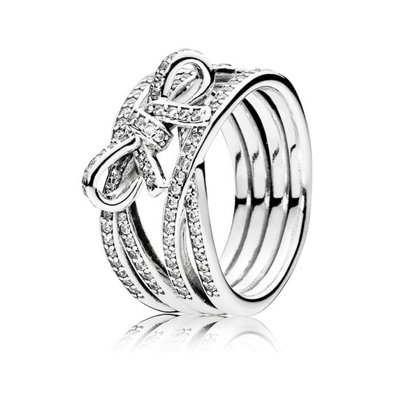 PANDORA's ring collection features fine silver and gold bands with intricate details and gemstone accents. Wear one or stack them together!
