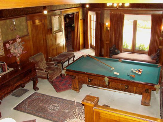 Billiard room, top down view. Love the style of this pool table.