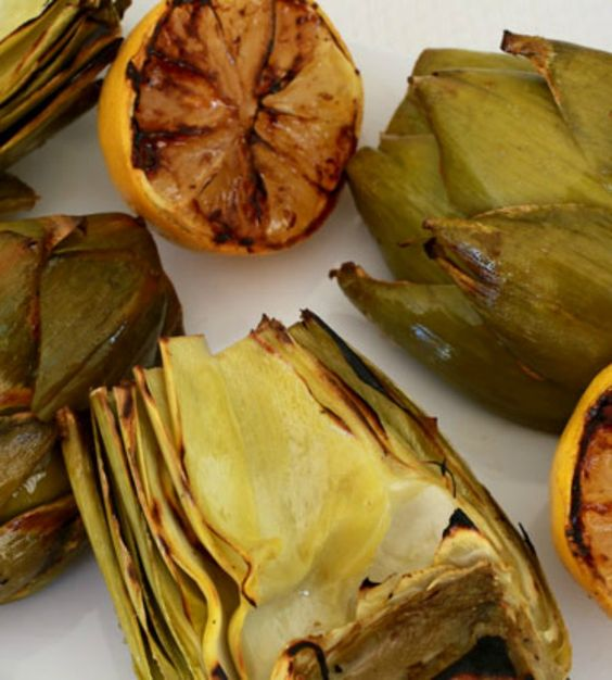 Grilled artichokes are the perfect side dish or appetizer for outdoor barbecues! Pair this smoky veggie with mayo, melted butter or ranch dressing.