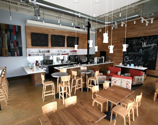 Thatcher s coffee shop showcases modern recycled design for Small coffee shop design ideas